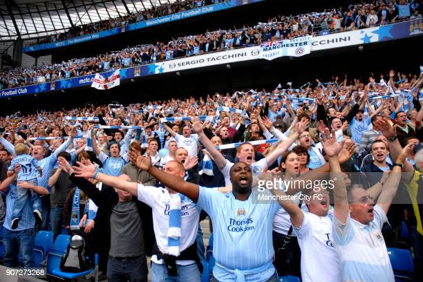 Barclays Premier League, Manchester City v Manchester United, City Of Manchester Stadium, Manchester City fans cheer on their team from the stands