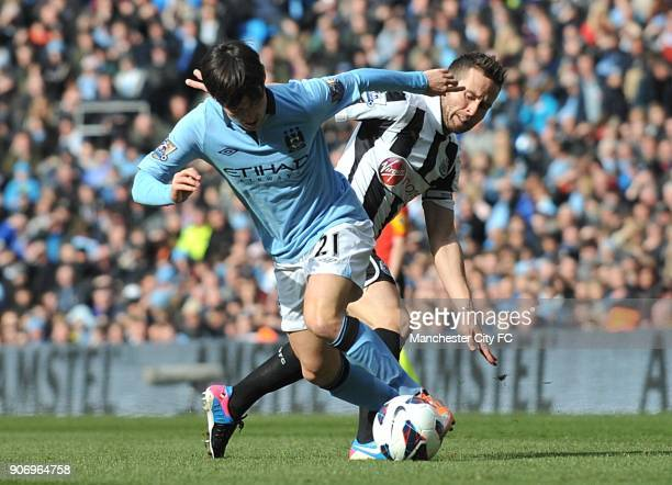 Barclays Premier League Manchester City v Newcastle United Etihad Stadium Manchester City's David Silva and Newcastle United's Yohan Cabaye battle...