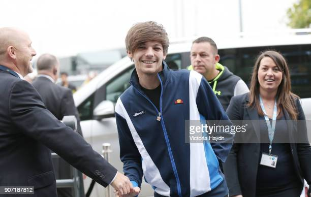 Barclays Premier League Manchester City v Newcastle United Etihad Stadium One Direction's Louis Tomlinson arrives at the Etihad Stadium