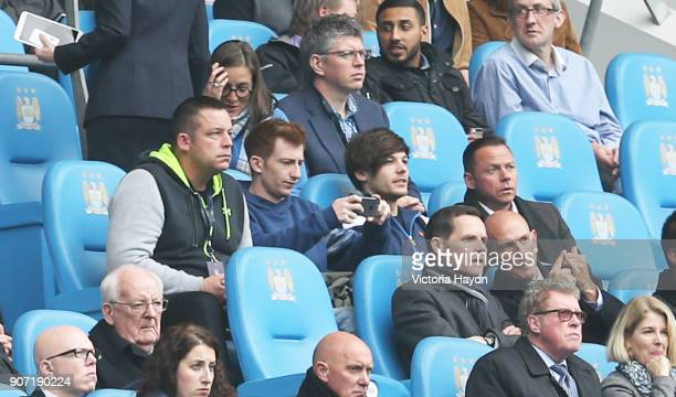 Barclays Premier League Manchester City v Newcastle United Etihad Stadium One Direction's Louis Tomlinson sat with Paul Dickov in the stands at the...