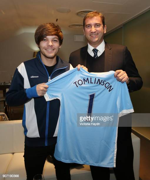 Barclays Premier League Manchester City v Newcastle United Etihad Stadium Manchester City's CEO Ferran Sorriano presents a shirt to One Direction...