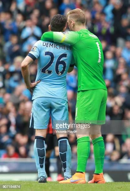 Barclays Premier League Manchester City v Queens Park Rangers Etihad Stadium Manchester City goalkeeper Joe Hart hugs teammate Martin Demichelis