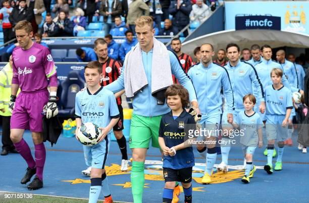 Barclays Premier League Manchester City v Queens Park Rangers Etihad Stadium Manchester City's Joe Hart walks on with mascots