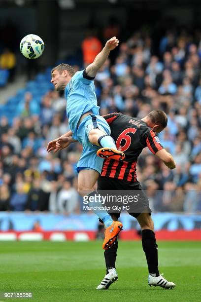 Barclays Premier League Manchester City v Queens Park Rangers Etihad Stadium Manchester City's James Milner and Queens Park Rangers' Clint Hill in...