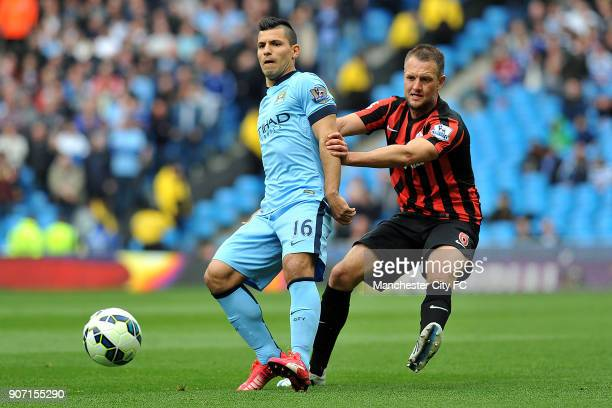 Barclays Premier League Manchester City v Queens Park Rangers Etihad Stadium Manchester City's Sergio Aguero and Queens Park Rangers' Clint Hill in...