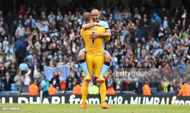 Barclays Premier League Manchester City v Southampton Etihad Stadium Manchester City's Pablo Zabaleta congratulates Joe Hart on the last game of the...