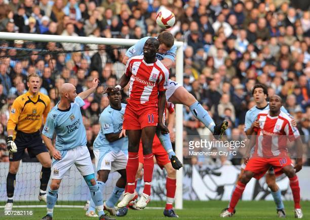 Barclays Premier League Manchester City v Stoke City City Of Manchester Stadium Manchester City's Richard Dunne and Stoke City's Mamady Sidibe battle...