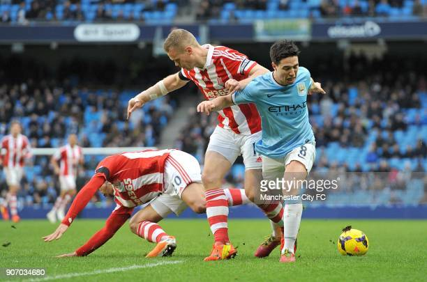 Barclays Premier League Manchester City v Stoke City Etihad Stadium Stoke City's Ryan Shawcross and Manchester City's Samir Nasri battle for the ball