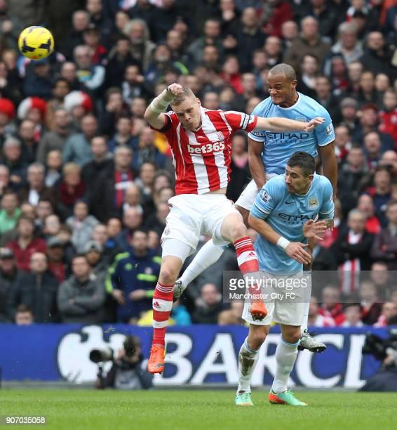 Barclays Premier League Manchester City v Stoke City Etihad Stadium Manchester City's Vincent Kompany and Stoke City's Ryan Shawcross battle for the...