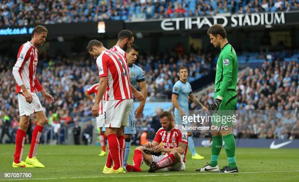 Barclays Premier League Manchester City v Stoke City Etihad Stadium Stoke City's Phil Bardsley sits as he puts his boot back on