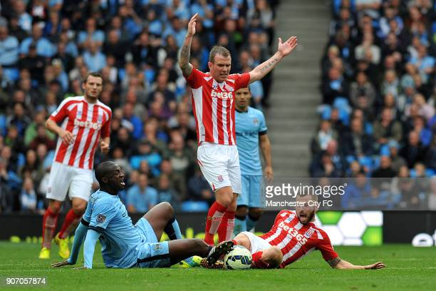 Barclays Premier League Manchester City v Stoke City Etihad Stadium Manchester City's Yaya Toure and Stoke City's Phil Bardsley battle for the ball