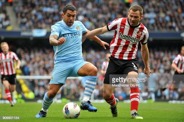 Barclays Premier League Manchester City v Sunderland Etihad Stadium Manchester City's Carlos Tevez and Sunderland's Phil Bardsley