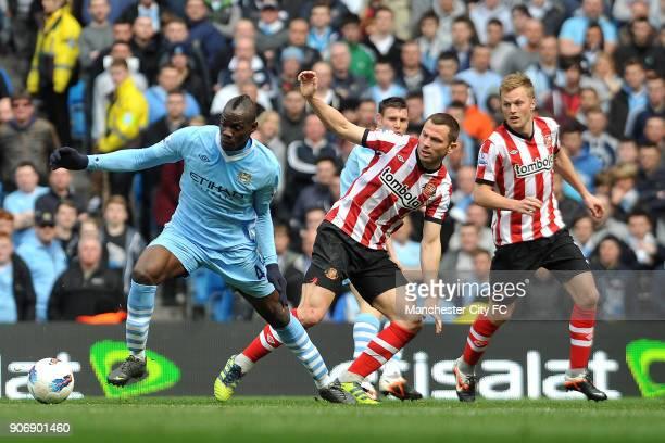 Barclays Premier League Manchester City v Sunderland Etihad Stadium Manchester City's Mario Balotelli turns Sunderland's Phil Bardsley