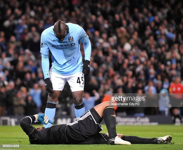 Barclays Premier League Manchester City v Swansea City Etihad Stadium Manchester City's Mario Balotelli stands over injured Swansea City goalkeeper...