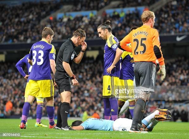 Barclays Premier League Manchester City v Swansea City Etihad Stadium Match referee Mark Clattenburg stands over Manchester City's Sergio Aguero