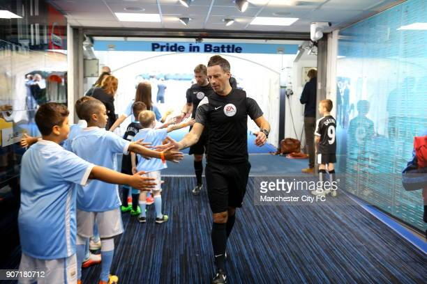 Barclays Premier League Manchester City v Watford Etihad Stadium Match referee Mark Clattenburg highfives mascots