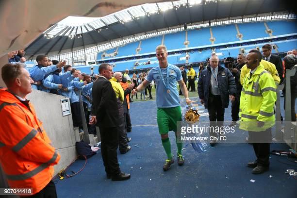 Barclays Premier League Manchester City v West Ham United Etihad Stadium Manchester City's goalkeeper Joe Hart brings in the Premier League trophy