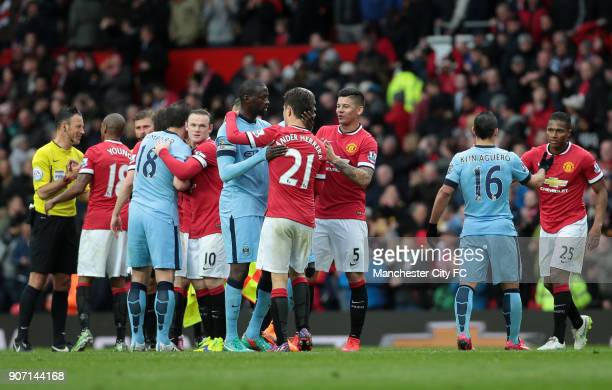 Barclays Premier League Manchester United v Manchester City Old Trafford Manchester City and Manchester United players speak with referee Mark...