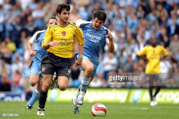 FA Barclays Premiership Manchester City v Arsenal City Of Manchester Stadium Arsenal's Francesc Fabregas leaves behind Manchester City's Joey Barton