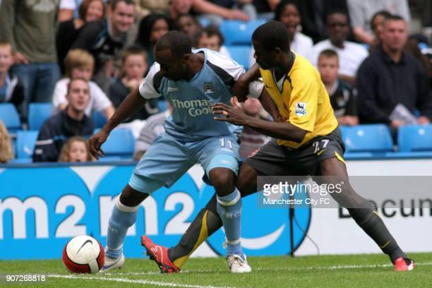 FA Barclays Premiership Manchester City v Arsenal City Of Manchester Stadium Manchester City's Darius Vassell and Arsenal's Emmanuel Eboue