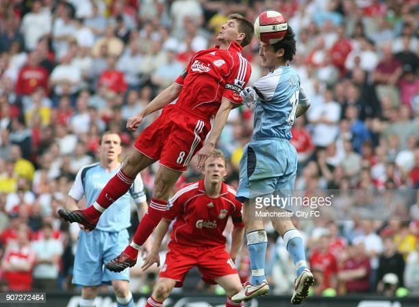 FA Barclays Premiership Manchester City v Liverpool The City of Manchester Stadium Liverpool's Steven Gerrard and Manchester City's Sun Jihai battle...