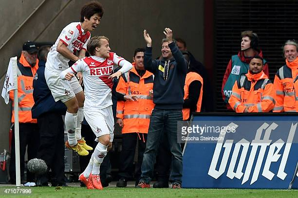 Bard Finne of Koeln celebrates with team mate Yuya Osako after scoring his team's first goal during the Bundesliga match between 1 FC Koeln and Bayer...