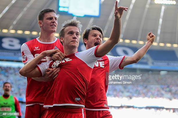 Bard Finne of Koeln celebrates with team mates after scoring his team's first goal during the Second Bundesliga match between TSV 1860 Muenchen and...