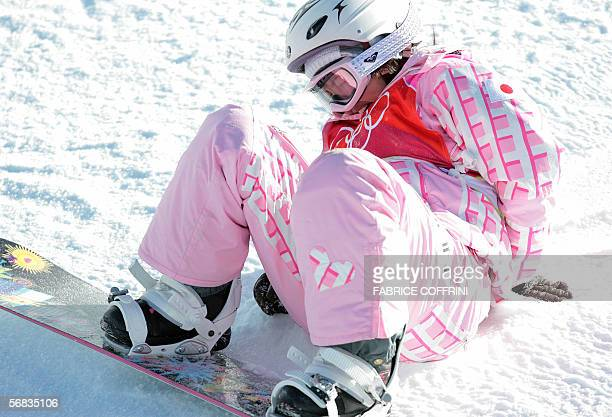 Japan's Melo Imai lies on the ground after falling during the second run of the Ladies' snowboard Halfpipe qualifying on the third day of the Turin...