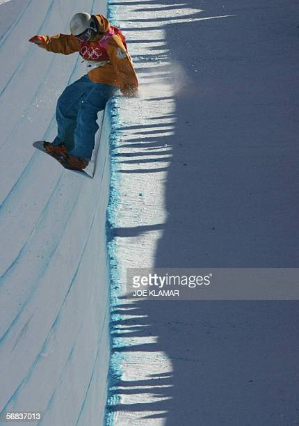 Netherlnad's Cheryl Maas hits the edge during the Ladies' snowboard Halfpipe final on the third day of the Turin 2006 Winter Olympics 13 February...