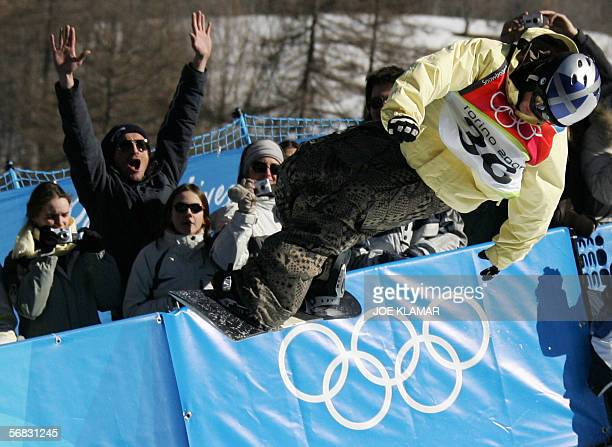 Swiss Halfpipe snowboarder Markus Keller competes during the Men's snowboard Halfpipe finals on the second day of the Turin 2006 Winter Olympics 12...