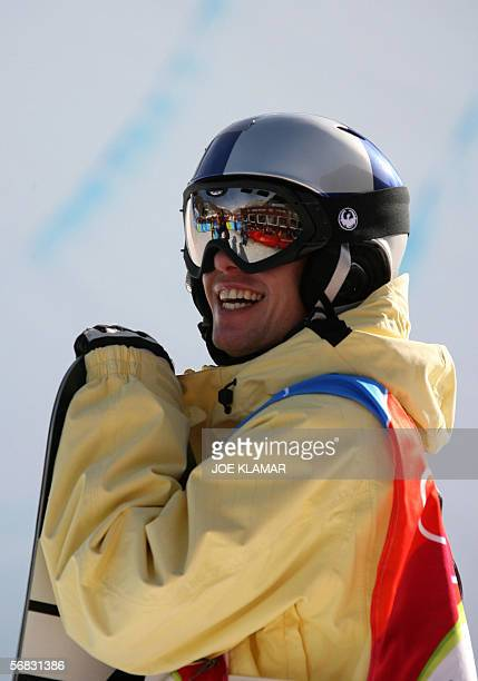 Swiss Halfpipe snowboarder Markus Keller smiles in the finish area of the Men's snowboard Halfpipe finals on the second day of the Turin 2006 Winter...