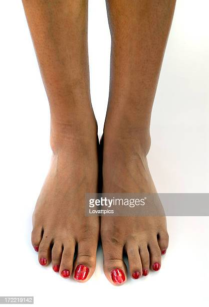 bare african american feet with red nail polish - pretty toes and feet stock photos and pictures
