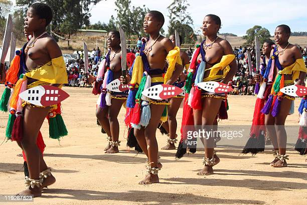 Bare breasted teenage girls dance in front of Swaziland's King Mswati III on July 15 2011 in Mankayane during his endorsement of a nationwide...