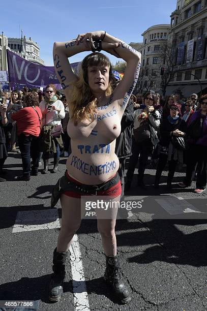 A bare bresated transexual demonstrates during the International Women's Day on March 8 2015 in Madrid AFP PHOTO / GERARD JULIEN