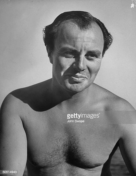 Bare chested Aly Khan at his chateau on the French Riviera