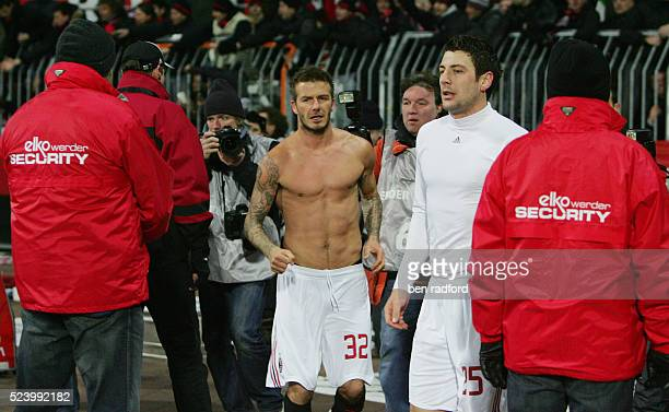 A bare chested David Beckham of AC Milan after throwing his shirt to the travelling Milan fans after the UEFA Cup match between Werder Bremen and AC...