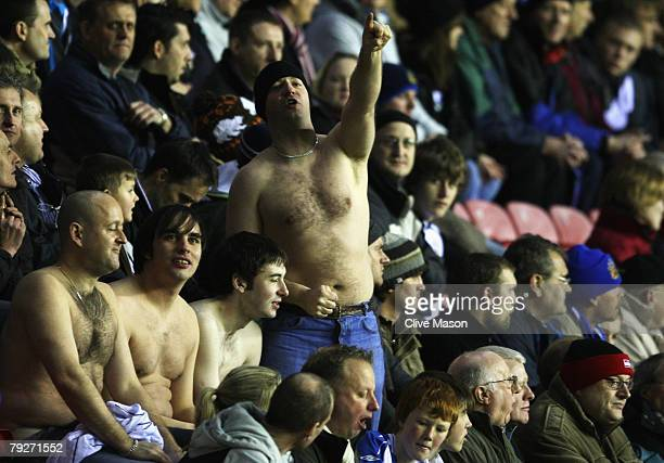 A bare chested fan gestures during the FA Cup sponsored by EON 4th Round match between Wigan Athletic and Chelsea at the JJB Stadium on January 26...