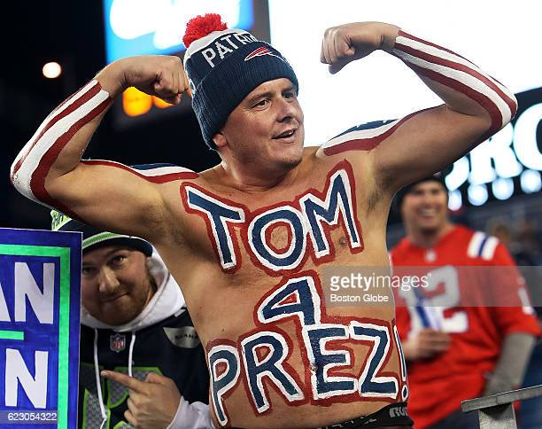 A bare chested fan wears his presidential pick Patriots quarterback Tom Brady on his torso The New England Patriots host the Seattle Seahawks at...