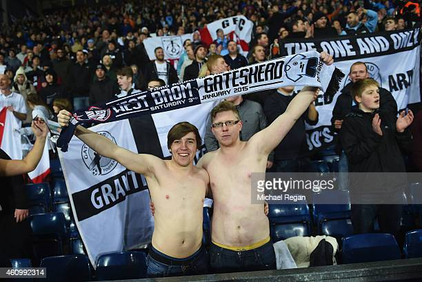 Bare chested Gateshead fans show their support during the FA Cup Third Round match between West Bromwich Albion and Gateshead at The Hawthorns on...