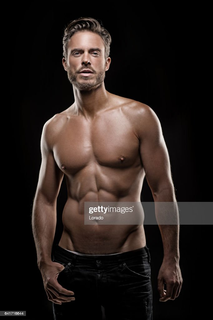 Bare Chested Handsome Male Posing For Studio Shot High-Res