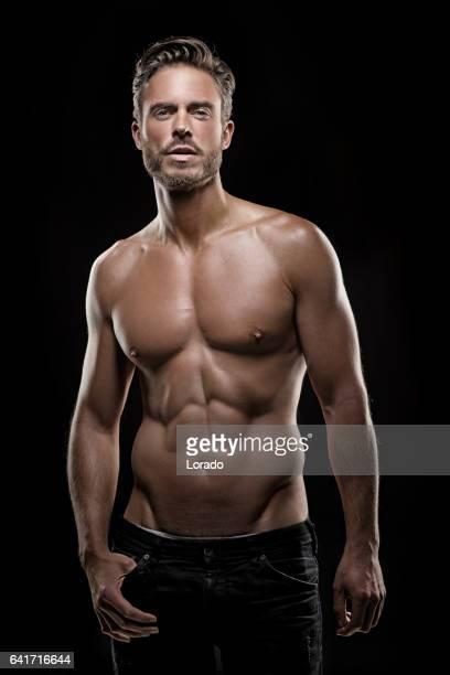 bare chested handsome male posing for studio shot - a petto nudo foto e immagini stock
