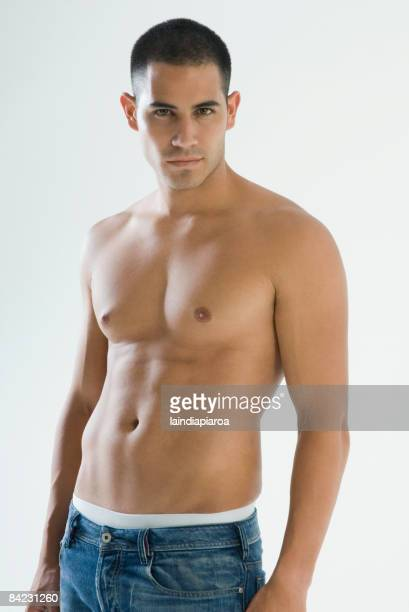 bare chested hispanic man - chest barechested bare chested stock-fotos und bilder