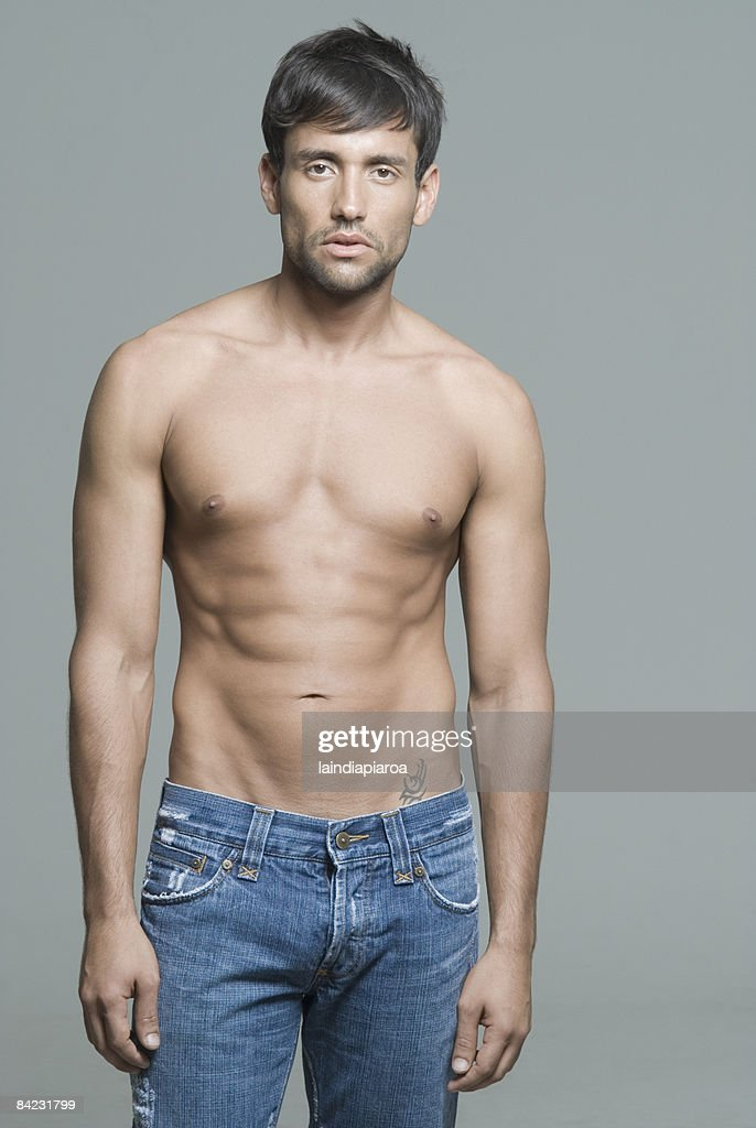 Bare chested Hispanic man : Stock Photo