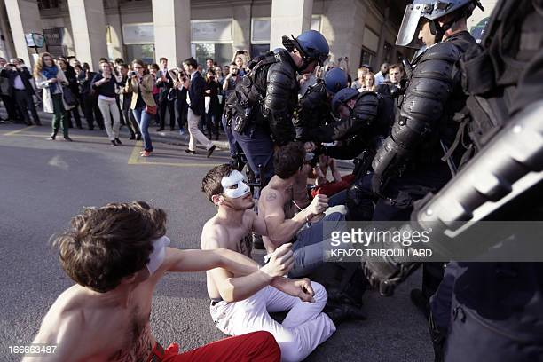Bare chested man belonging to the antigay marriage group Hommen gather in a street of Paris on April 15 2013 The final vote on France's landmark bill...