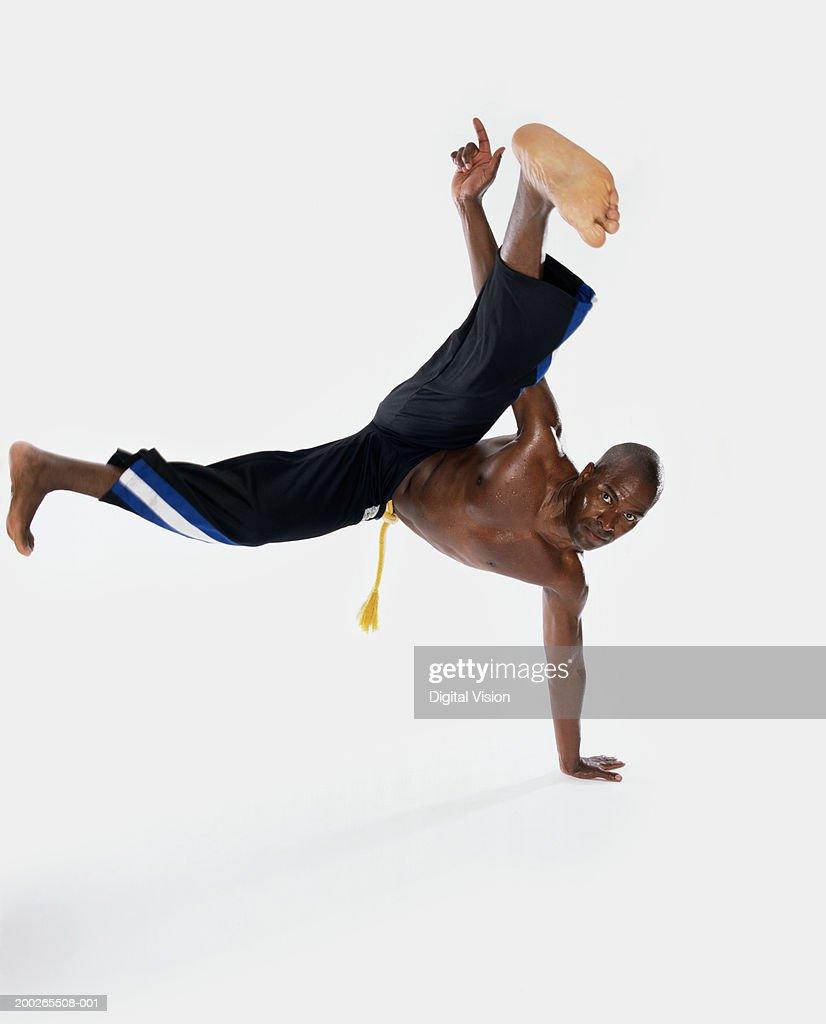 Bare chested man break-dancing : Stock Photo