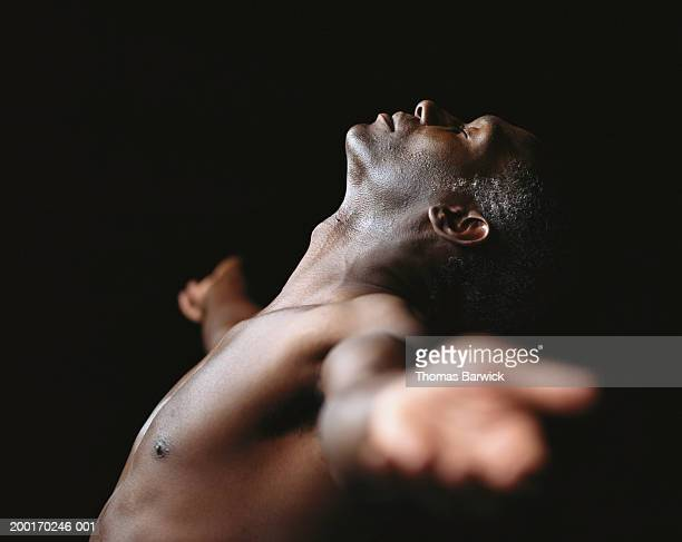 bare chested man leaning back, arms outstretched, eyes closed - chest barechested bare chested foto e immagini stock