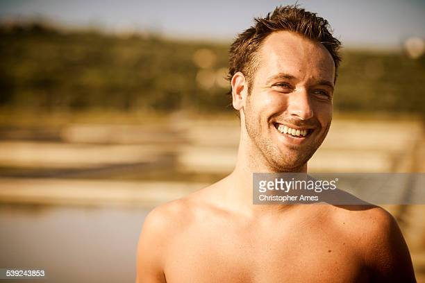 Bare Chested Man Taking a Break Outdoors in Summer