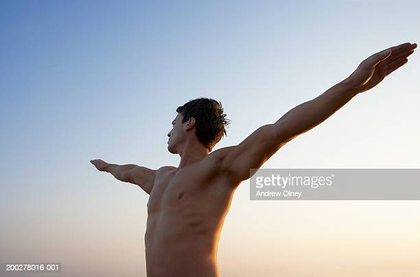 bare chested man with arms outstretched and head turned to side - chest barechested bare chested fotografías e imágenes de stock
