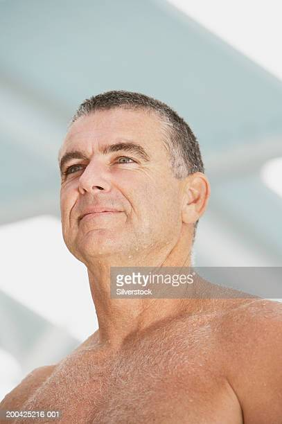 bare chested mature man, smiling, low angle view, close-up - chest barechested bare chested fotografías e imágenes de stock