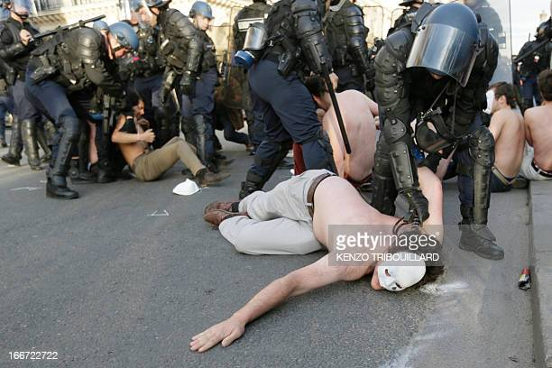 Bare chested men members of the antigay marriage group Hommen are arrested by riot police as they try to block one of Paris's main street on April 15...